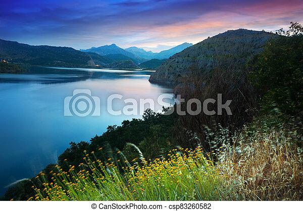 mountains lake in summer sunrise - csp83260582