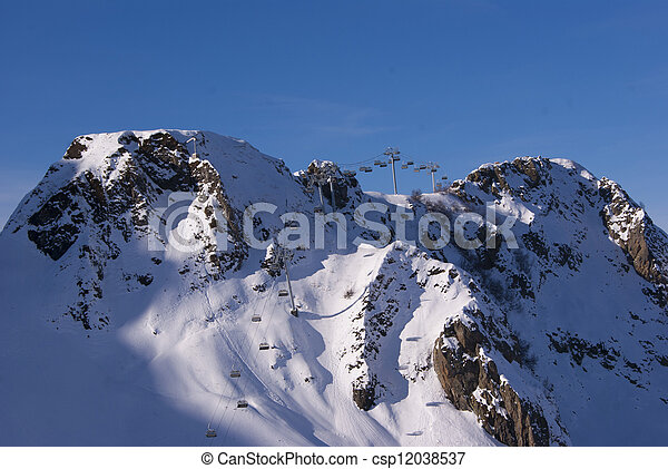 Mountains with a cable car in the far - csp12038537