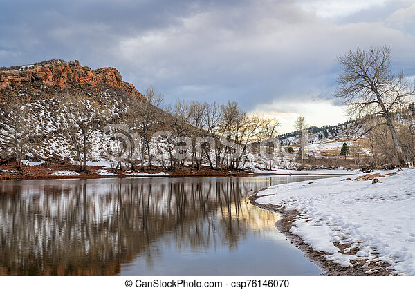 moutain lake in winter scenery at Colorado foothills - csp76146070