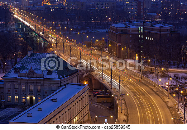 Movement of cars on the night street in Warsaw in the winter, the top view - csp25859345