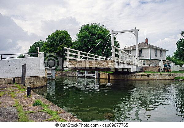 Moving a swing bridge aside - csp69677765