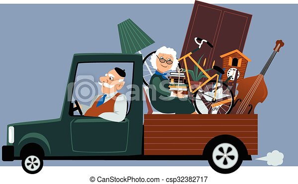 Moving seniors. Senior couple in a pick-up truck moving ...