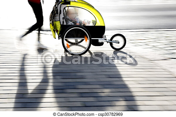 moyther with yellow pram - csp30782969