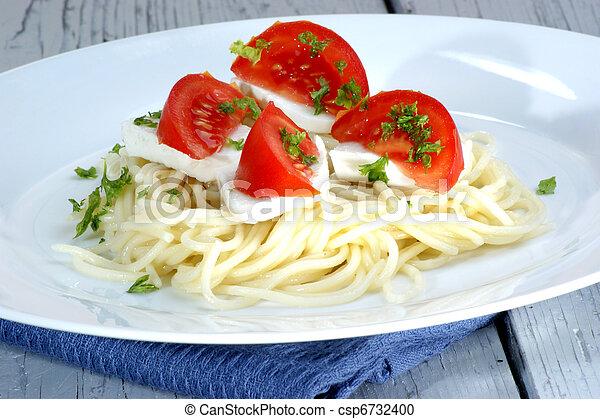 Mozzarella with tomatoes on home made spaghetti - csp6732400