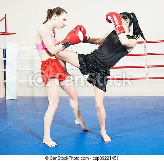 Muay thai woman fighting at boxing ring - csp39221451