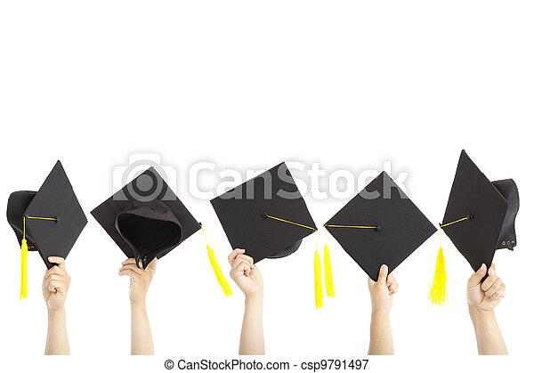 Muchos sostienen sombreros de graduación y están aislados en blanco - csp9791497