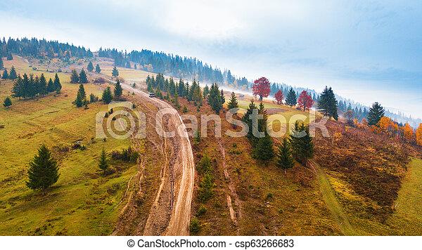 Muddy hillside in autumn rainy season. - csp63266683