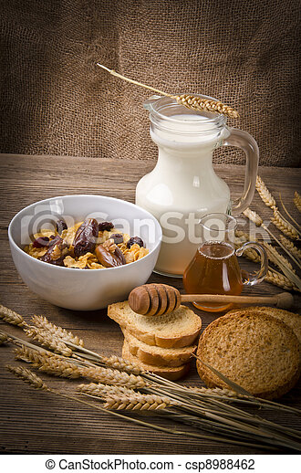 Muesli with low-fat milk and rusk - csp8988462