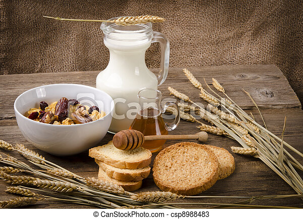 Muesli with low-fat milk and rusk - csp8988483