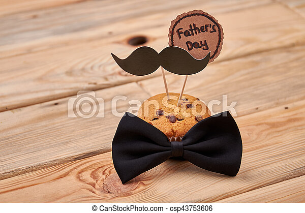 Muffin with mustache on wood. - csp43753606