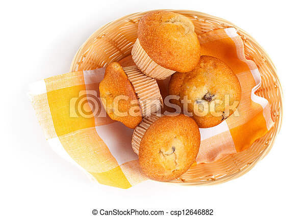 Muffins in a basket isolated on white background - csp12646882