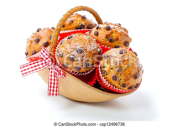 Muffins in a basket isolated on white background - csp12496736