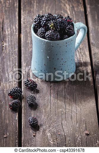 Mug of blueberries - csp43391678