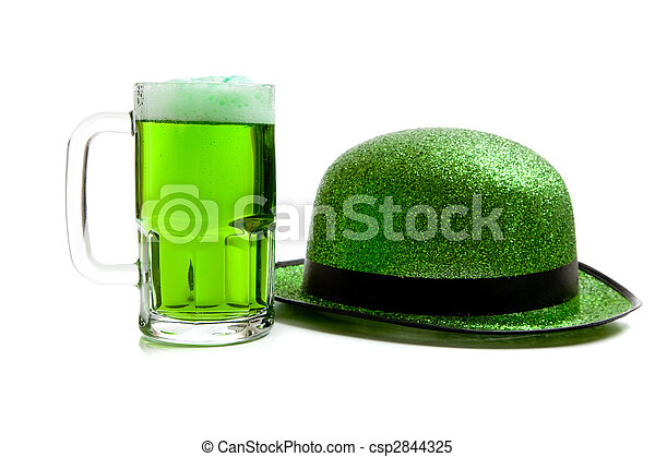 Mug of green beer and green glitter hat on white - csp2844325
