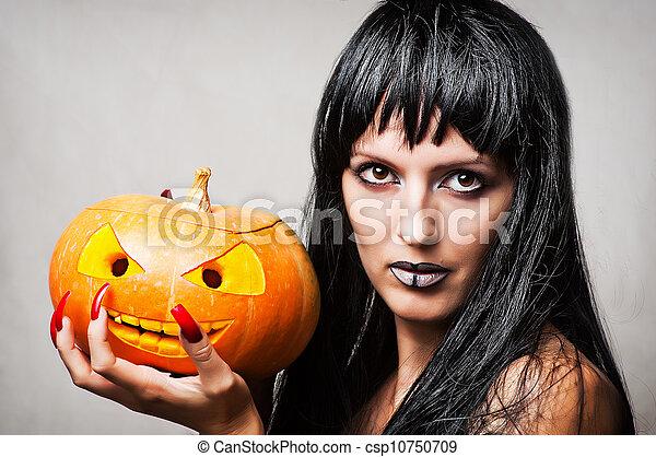 Mujer bruja con calabaza - csp10750709