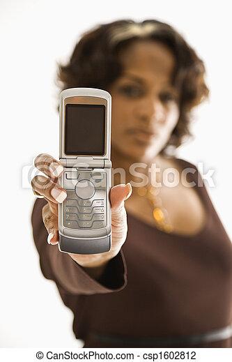 Mujer sosteniendo el celular. - csp1602812