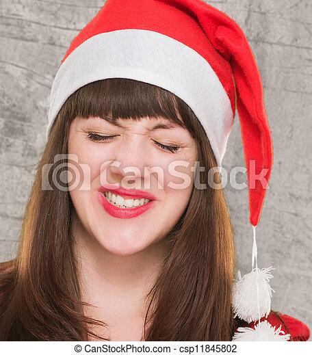 El primer plano de una mujer navideña molesta - csp11845802