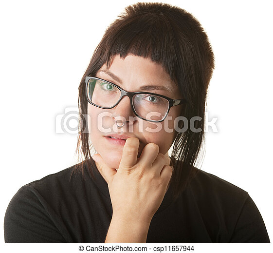 Una joven caucásica mirando y mordiendo su uña - csp11657944