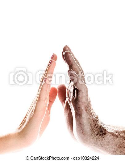Manos de mujer joven y anciano sobre fondo blanco - csp10324224