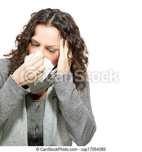 Mujer enferma. Gripe. Una mujer se resfrió. Estornudando en tejido - csp17054385