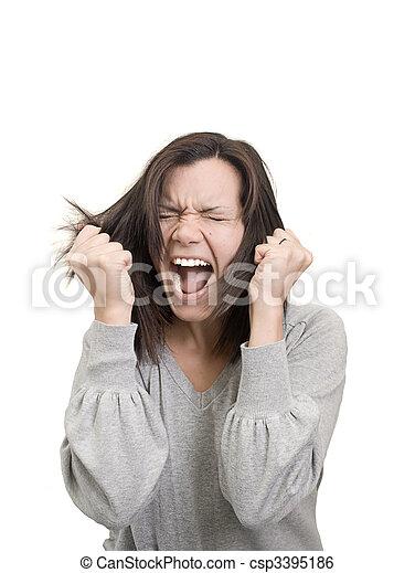La mujer grita y se tira del pelo con frustración - csp3395186