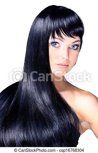 Retrato de una hermosa joven con elegante cabello largo y brillante. Aislado de fondo blanco - csp16768304