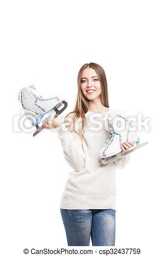 Mujer joven con un par de patines aislados - csp32437759