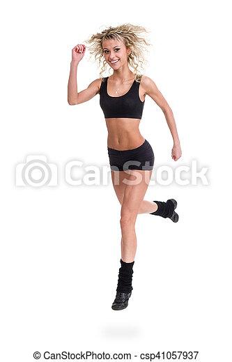 Aerobics fitness mujer saltando aislado en cuerpo completo. - csp41057937
