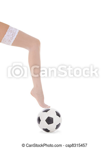 Una pierna de mujer con medias blancas en la pelota de fútbol - csp8315457