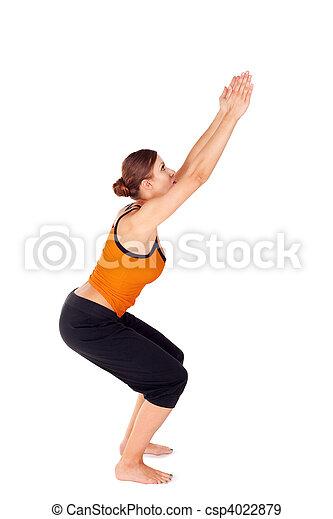 una mujer practicando ejercicio de yoga llamada postura de