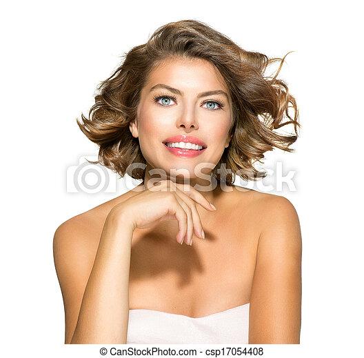 Retrato de bella joven sobre blanco. Cabello rizado corto - csp17054408