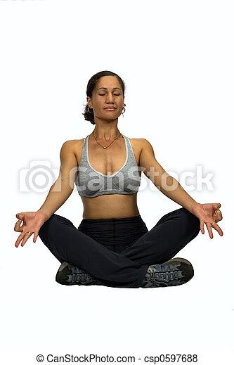 Una mujer africana yoga - csp0597688