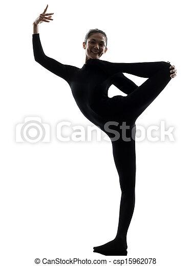 Mujer contorsionista haciendo ejercicio gimnasta de yoga - csp15962078