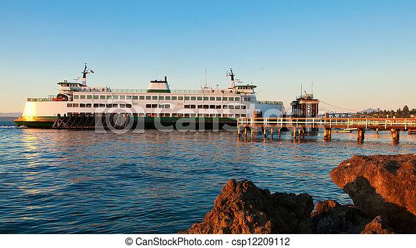 Mukilteo to Bainbridge Washington State ferry during sunset. - csp12209112