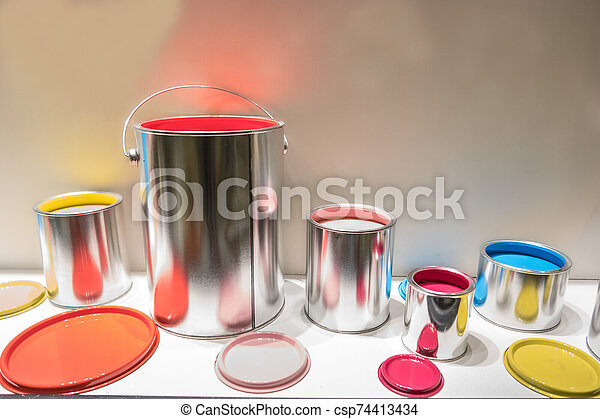 multi colored paint cans, red yellow green blue and pink - csp74413434