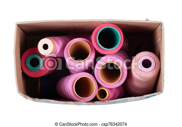 Multi-colored spools of thread on a white background - csp76342074