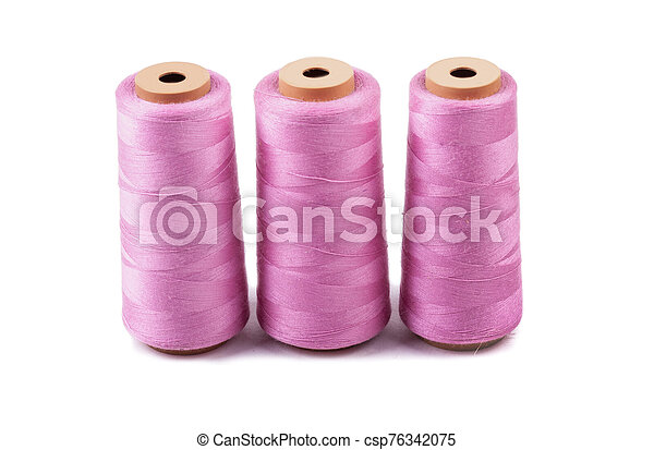 Multi-colored spools of thread on a white background - csp76342075