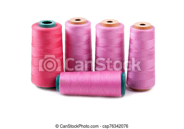 Multi-colored spools of thread on a white background - csp76342076