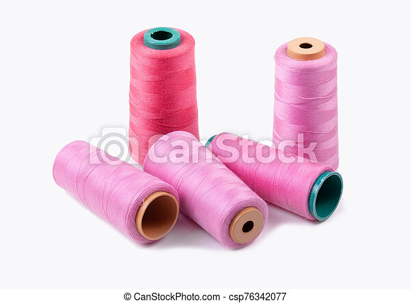 Multi-colored spools of thread on a white background - csp76342077