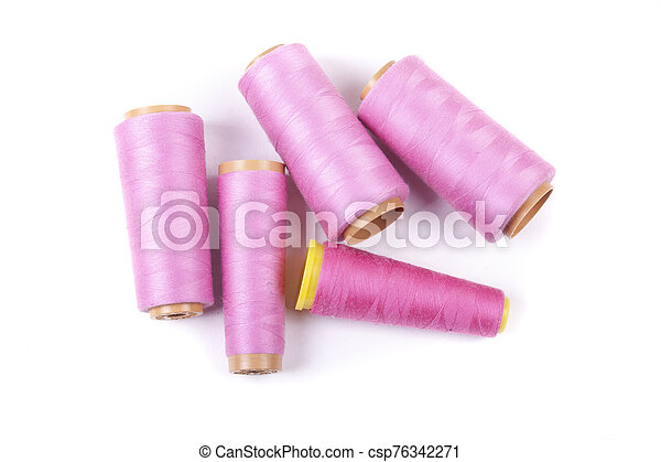 Multi-colored spools of thread on a white background - csp76342271