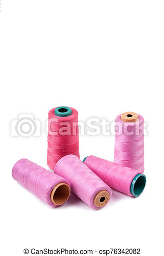 Multi-colored spools of thread on a white background - csp76342082