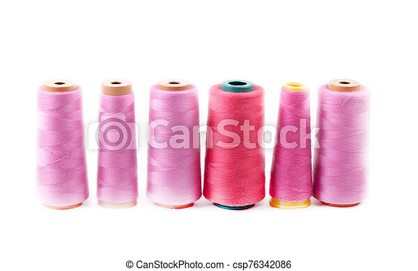 Multi-colored spools of thread on a white background - csp76342086