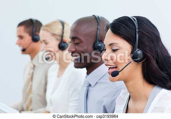 Multi-cultural business people working in a call center - csp3193984