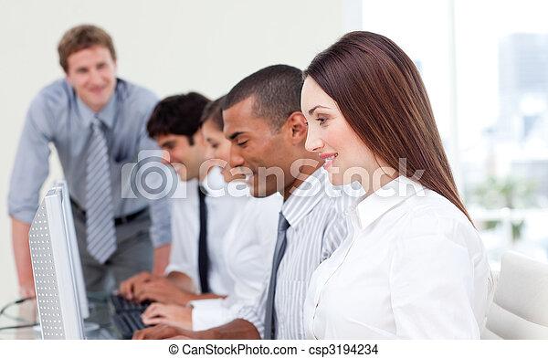 Multi-cultural business team at work - csp3194234