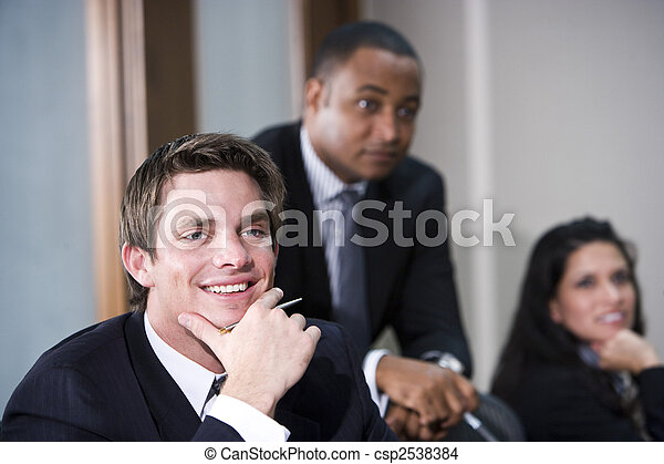 Multi-ethnic business executives meeting in boardroom - csp2538384