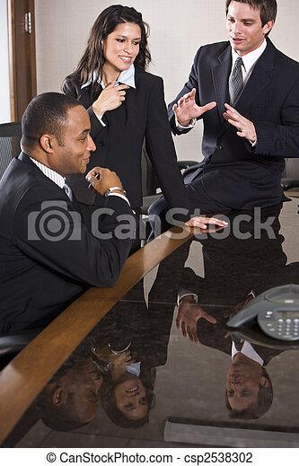 Multi-ethnic business meeting in boardroom - csp2538302