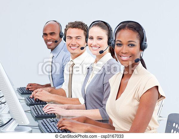 Multi-ethnic customer service representatives using headset - csp3167033
