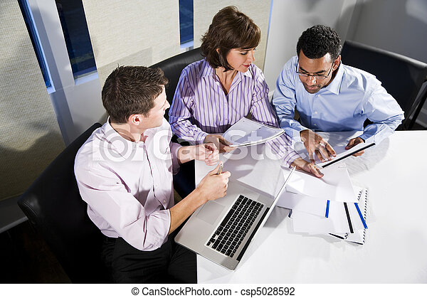 Multi-ethnic office workers working on project - csp5028592