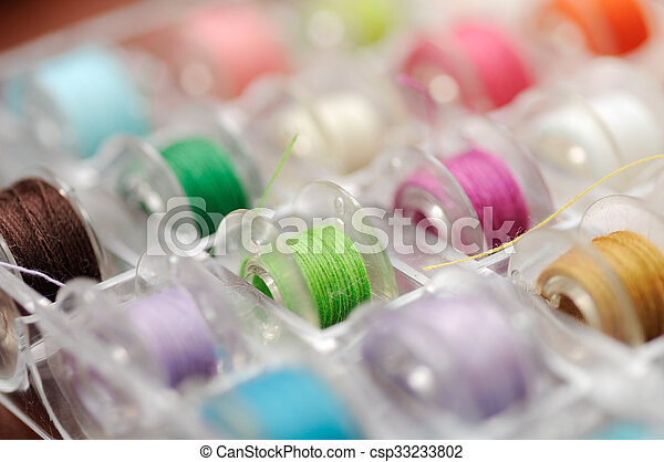 Multicolored thread shallow depth of field (soft focus) - csp33233802