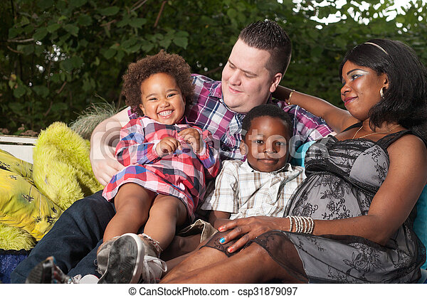 Multicultural family on the couch - csp31879097